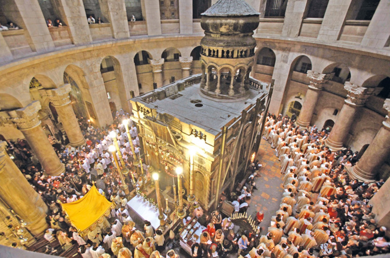 Roman Catholic clergy men hold candles a